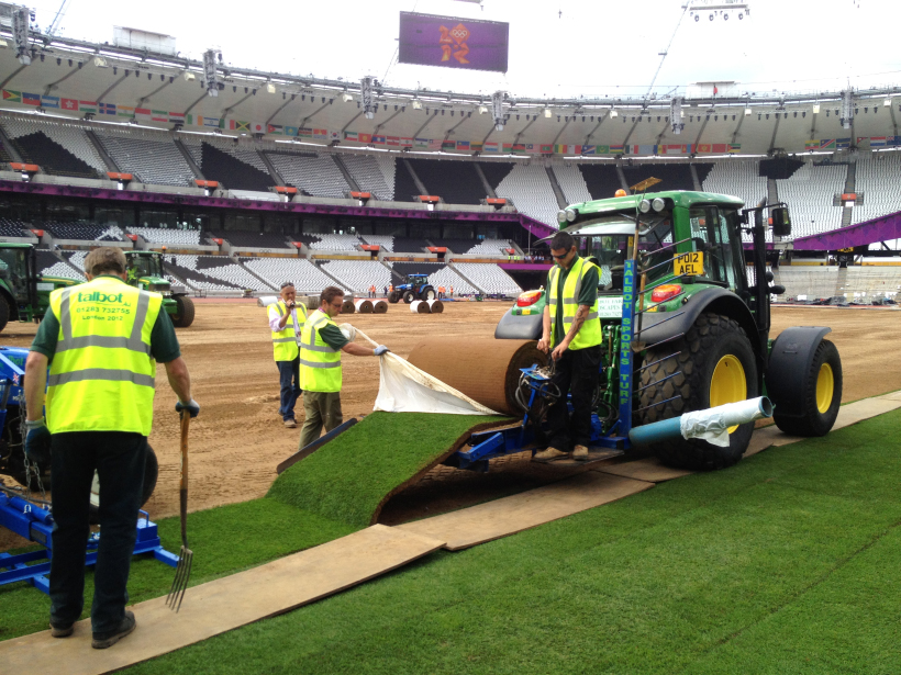 Talbots get to work laying turf at the London 2012 Olympics